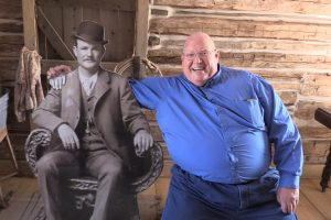 State Parks Director Fred Hayes posing with a cutout of Butch Cassidy.