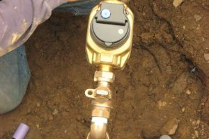 Secondary water meter being installed